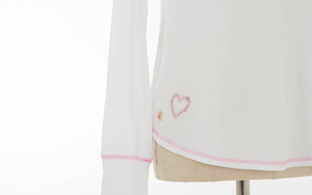 A white long sleeved tee with pink heart